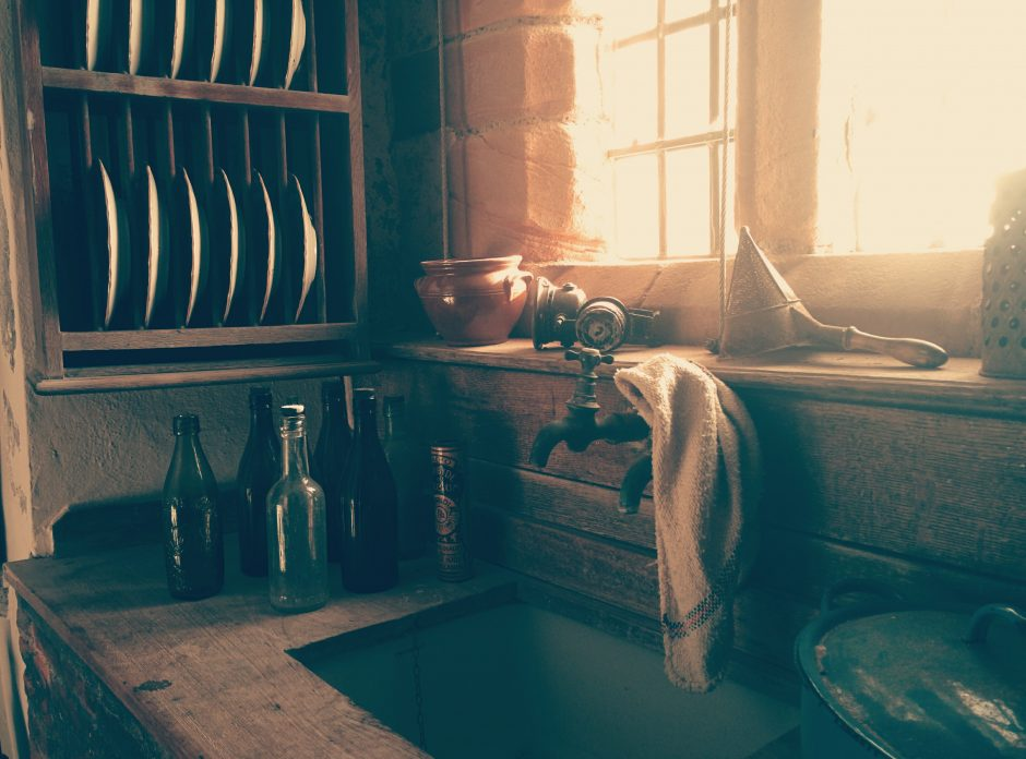 A rustic, antique kitchen in the warm, glowing morning light.
