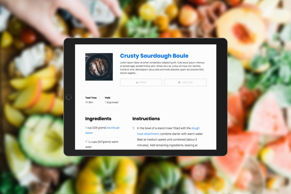 An iPad loaded with the Simmer Pro v2.3 recipe design over fresh food.
